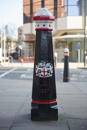 city coat of arms: LONDON, UK - APRIL 06: Black City of London bollard featuring its coat of arms. April 06, 2015 in London. Editorial