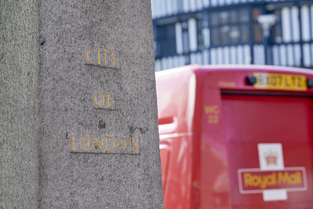 obelisk stone: LONDON, UK - APRIL 07: Detail of City of London sign on stone obelisk, with Royal Mail red van in the blurred background. April 07, 2015 in London.