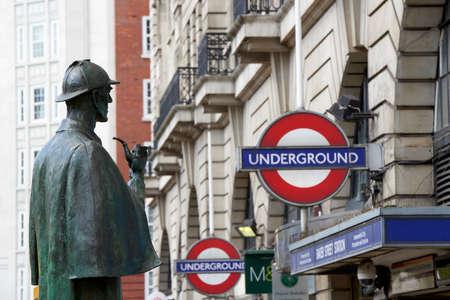 LONDON, UK - APRIL 22: Bronze statue of Sherlock Holmes in front of Baker Street station. April 22, 2015 in London. The statue was commissioned by the Sherlock Holmes Society in 1999.