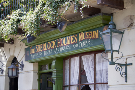 holmes: LONDON, UK - APRIL 22: Detail of banner in the entrance to the Sherlock Holmes museum. April 22, 2015 in London.