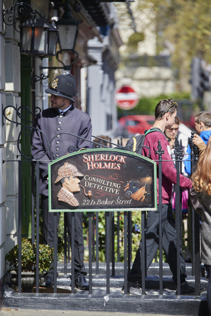 LONDON, UK - APRIL 22: An actor dressed in traditional English police uniform manages visitors to the Sherlock Holmes museum. April 22, 2015 in London. Editorial