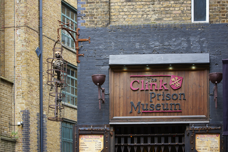 clink: LONDON, UK - JUNE 23: Entrance to The Clink prison museum, which exhibits medieval torture tools, with replica of skeleton in cage. June 23, 2015 in London. Editorial