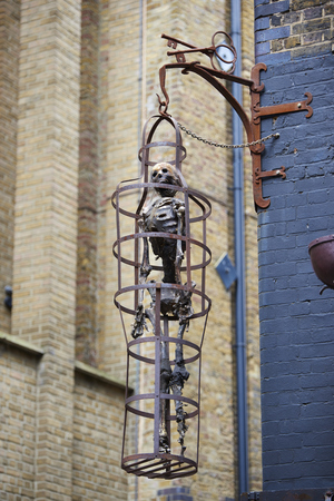 clink: LONDON, UK - JUNE 23: Replica of skeleton in cage at the entrance to The Clink prison museum, which exhibits medieval torture tools. June 23, 2015 in London. Editorial
