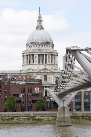 millennium bridge: LONDON, UK - JUNE 23: Dome of Saint Pauls cathedral, with Millennium Bridge in the foreground. June 23, 2015 in London.