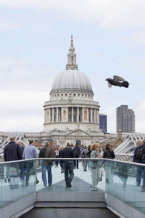 saint pauls cathedral: LONDON, UK - JUNE 23: Dome of Saint Pauls cathedral, with people crossing Millennium Bridge in the foreground. June 23, 2015 in London. Editorial