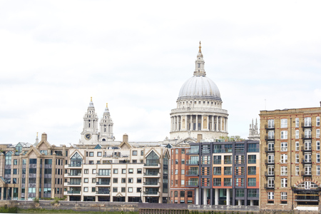 saint pauls cathedral: LONDON, UK - JUNE 23: Dome of Saint Pauls cathedral surrounded by lower buildings, seen from Blackfriars. June 23, 2015 in London. Editorial
