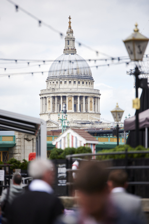 saint pauls cathedral: LONDON, UK - JUNE 23: Dome of Saint Pauls cathedral seen from Blackfriars, with blurred people in the foreground. June 23, 2015 in London.
