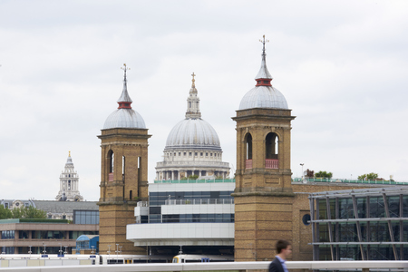 saint pauls cathedral: LONDON, UK - JUNE 23: Dome of Saint Pauls cathedral framed by bridge towers, seen from Blackfriars. June 23, 2015 in London.
