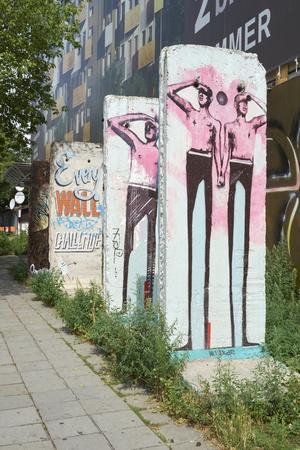 east berlin: BERLIN, GERMANY - JULY 07: Segments of Berlin Wall in East Berlin filled with grafitti art. July 07, 2015 in Berlin. Editorial