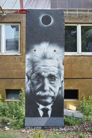 theorist: BERLIN, GERMANY - JULY 07: Segment of Berlin Wall in East Berlin with Albert Einstein portrait painted on. July 07, 2015 in Berlin.