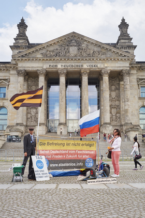 protesters: BERLIN, GERMANY - JULY 08: Protesters in front of Reichstag building. July 08, 2015 in Berlin.
