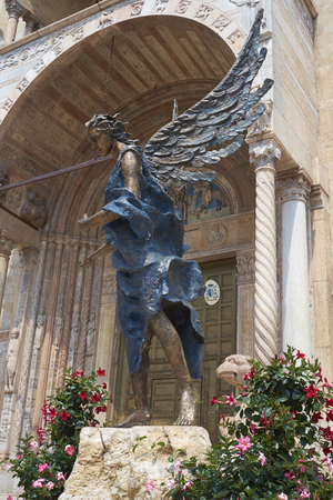 acceptance: VERONA, ITALY - JULY 13: Bronze statue The Blue Angel of Acceptance, or Hospitality, by Albano Poli, in front of Duomo di Verona Cathedral. July 13, 2015 in Verona. Editorial