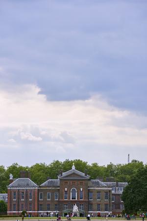 kensington: LONDON, UK - AUGUST 17: Facade of Kensington Palace, in Kensington Gardens, with cloudy sky. August 17, 2015 in London.