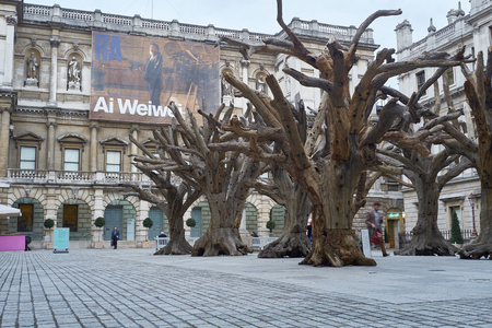 LONDON, UK - SEPTEMBER 23: Ai Wei Weis installation Tree in the forecourt of the Royal Academy of Arts. September 23, 2015 in London. Editorial