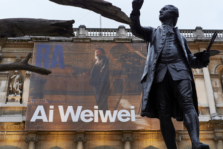 wei: LONDON, UK - SEPTEMBER 23: Statue of Sir Joshua Reynolds with Ai Wei Weis banner in the background, at the forecourt of the Royal Academy of Arts. September 23, 2015 in London. Editorial