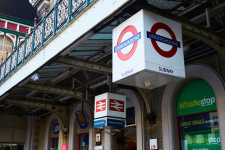 rail cross: LONDON, UK - DECEMBER 19: Entrance to Charing Cross station with signs depicting London Underground and rail logos. December 19, 2015 in London.