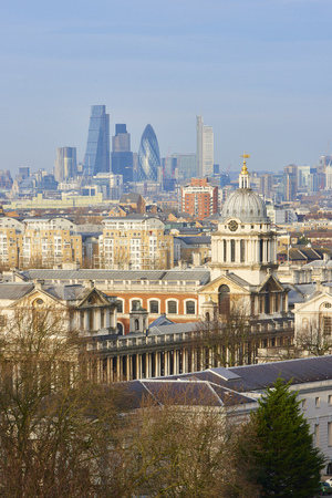 greenwich: LONDON, UK - DECEMBER 28: Heavily built cityscape with National Maritime museum spires in the foreground and City of London skyscrapers in the background. December 28, 2015 in London.