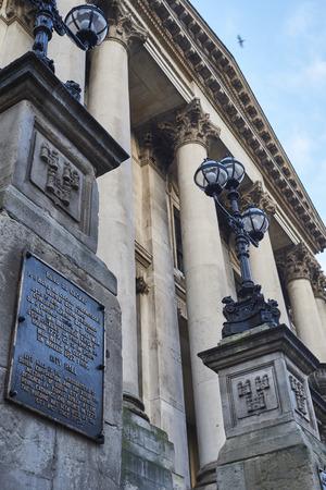 ade: DUBLIN, IRELAND - JANUARY 05: Low angle detail of the Dublin City Hall entrance plaque, in both Irish Celtic and English. January 05, 2016 in Dublin