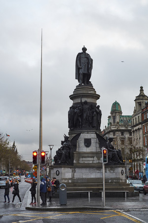 spire: DUBLIN, IRELAND - JANUARY 05: Statue of Daniel OConnell with overcast sky and Millennium Spire in the background. January 05, 2016 in Dublin