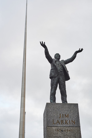 jim: DUBLIN, IRELAND - JANUARY 05: Statue of Jim Larkin with Millennium Spire in the background, in overcast day. January 05, 2016 in Dublin Editorial