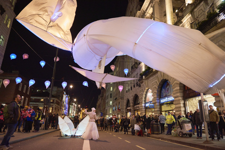 par: LONDON, UK - JANUARY 14: Les Luminoles installation by art group Port par le vent. The fish-like illuminated kites are part of the Lumiere London. January 14, 2016 in London. Editorial