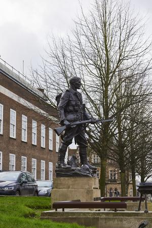 side shot: TUNBRIDGE WELLS, UK - JANUARY 26: Side shot of bronze War memorial depicting soldier holding rifle. January 26, 2016 in Tunbridge Wells.