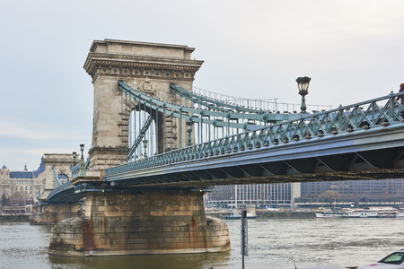 the chain bridge: Low angle shot of Szchenyi Chain Bridge accross Danube River. February 02, 2016 in Budapest, Hungary. Stock Photo