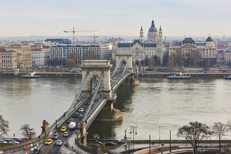 the chain bridge: High angle shot of Szechenyi Chain Bridge with heavy traffic, accross Danube River. February 02, 2016 in Budapest, Hungary.