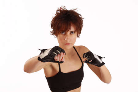 a young and fit female fighter posing in combat poses photo