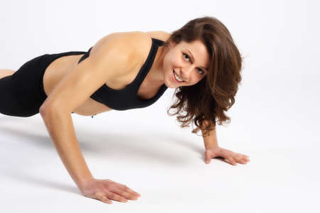 pushup: Portrait of a healthy woman fitness push-up exercises