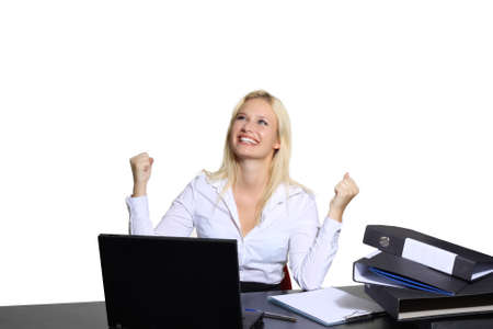 Exulting young businesswoman sitting at a laptop photo
