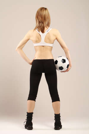 Back view of a young woman with ball photo