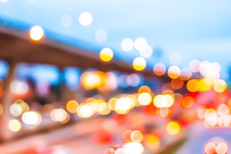 blurry: Blurry light on street background