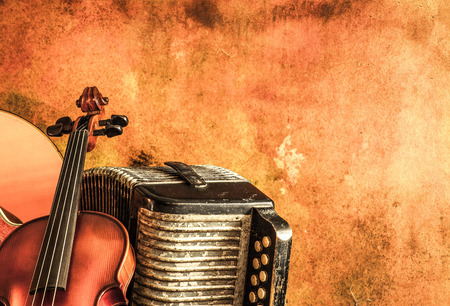 Vintage accordion and violin with still life style