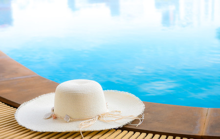 Hat beside the pool Stock Photo