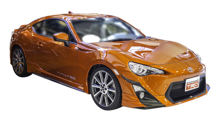 toyota: Orange Toyota GT 86 Sports Car on white backgroun with workpaths