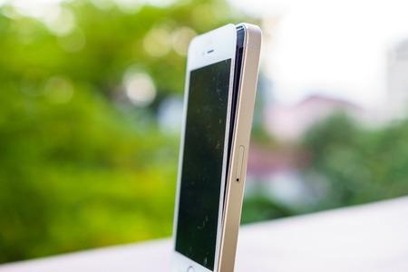 swells: Swollen defective battery of a smartphone