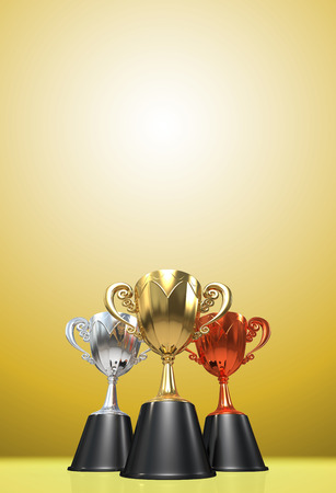 copy space: 3D rendering gold, silver and bronze  awards winners cup sitting on yellow tone background. Three cup trophies. Winners cup. Copy space on top. Stock Photo