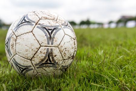 muddy: Muddy soccer ball on a football field. Stock Photo