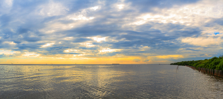 Tranquil scene cloudy sea sunset at Bang Poo Recreational Retreat, Samut Prakan, Thailand. Stock Photo