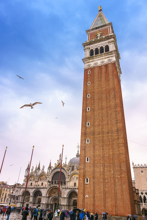 Venice, Italy - April 27, 2017: Campanile of St Marks Church and St Marks Basilica in Venice, Italy. Editorial