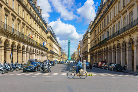 Paris, France - May 2, 2017: Traffic conditions on Castiglione Street and the beautiful old architecture along the way with Place Vendome Square in a background on May 2, 2017, in Paris, France.