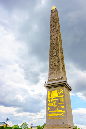 obelisk stone: Paris, France - May 3, 2017: The Obelisk of Luxor at the center of the Place de la Concorde with cloudy sky, on May 3, 2017, in Paris, France.