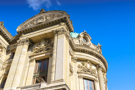 Paris, France - May 2, 2017: Beautiful architecture on the side of The of Opéra Garnier with blue sky background on May 2, 2017, in Paris, France. Editorial