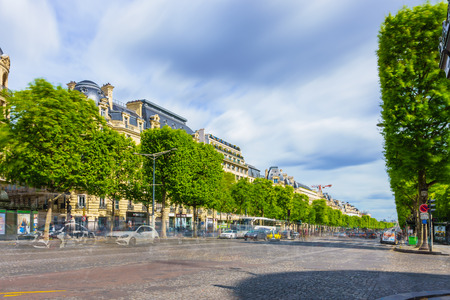 champs elysees: Paris, France - May 1, 2017: Long Exposure view of Champs-Élysées Avenue with cloudy sky background on May 1, 2017, in Paris, France.