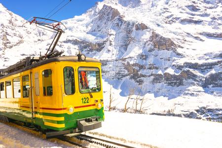 Jungfraujoch, Switzerland - April 29, 2017: Old style trains among the mountains near Kleine Scheidegg Station at Jungfrau, Switzerland.