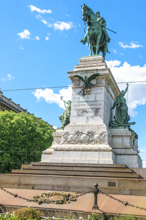 sforza: Milan, Italy - April 28, 2017: Monument to Giuseppe Garibaldi in the square in front of the Sforzesco Castle in Milan, Italy.