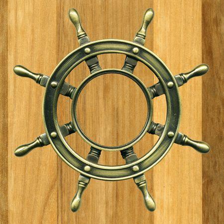 maneuver: bronze wheel on a wooden board