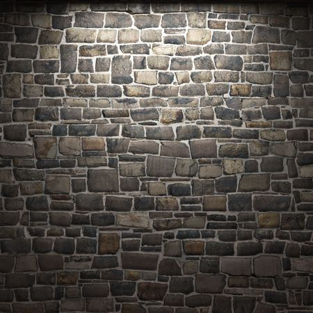 castle interior: illuminated stone wall Stock Photo