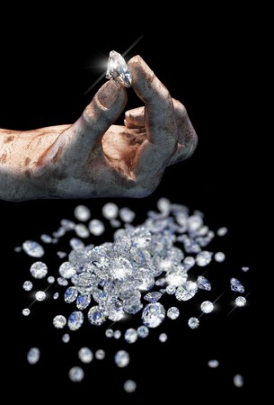Diamonds on black surface and hand Stock Photo - 7068420